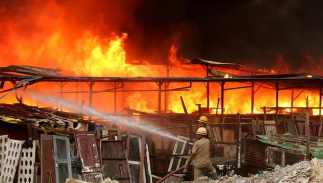 Firefighters douse fire at a furniture market in Shaheen Bagh, near Kalindi Kunj station, in New Delhi, India, on Friday, June 21, 2019.(Photo: Salman Ali / Hindustan times)