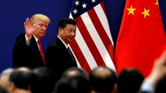 """The Chinese Communist Party's newspaper urged the United States to cancel all tariffs on Chinese goods, saying the only way to resolve trade issues was through """"equal dialogue"""".(Reuters File Photo)"""