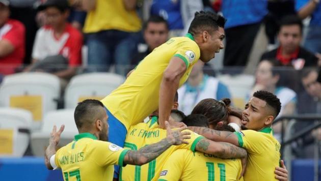 Brazil's Everton celebrates scoring their third goal with team mates(REUTERS)