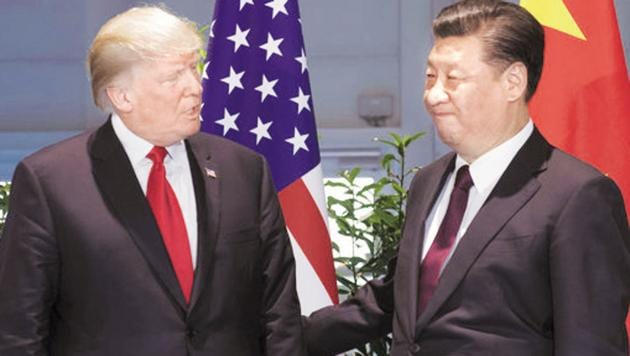 Ahead of their planned meeting, Trump and Xi held a detailed telephone talk on June 18 preparing ground to resolve differences impeding the deal to end the year long trade war between the world's two largest economies.(AP File Photo)