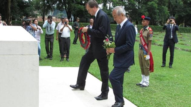 British High Commissioner to India Dominic Asquith and Japanese Ambassador to India Kenji Hiramatsu paying floral tributes at the Commonwealth War Cemetery in Imphal, Manipur on Saturday.(HT PHOTO)