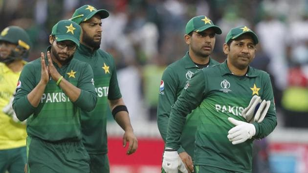 Pakistan's captain Sarfaraz Ahmed right leads the team from the field as they celebrate after they defeated South Africa by 49 runs in their Cricket World Cup match between Pakistan and South Africa(AP)