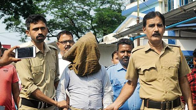 Kamruzzaman Sarkar, the 37-year-old suspected serial killer, is brought to the Kalna court for hearing, at Kalna, in East Burdwan district of West Bengal, India. (Photo Samir Jana / Hindustan Times)