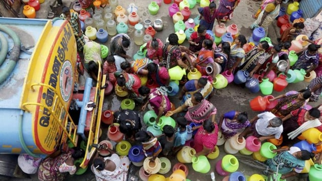 Indians stand in queues to fill vessels with drinking water from a water tanker in Chennai, capital of the southern Indian state of Tamil Nadu.(AP file photo)
