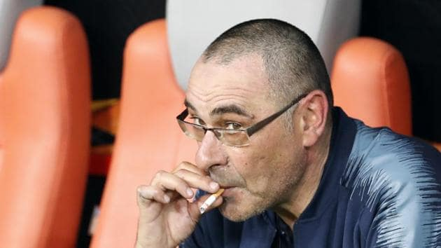 File image of former Chelsea head coach Maurizio Sarri smokes a cigarette on the bench after winning the Europa League Final(AP)