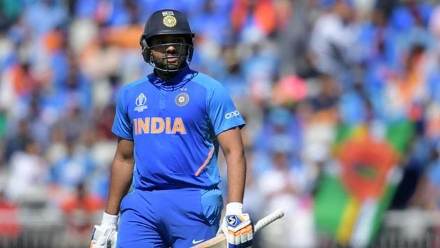 Rohit Sharma leaves the pitch after losing his wicket for 18 during the 2019 Cricket World Cup group stage match between West Indies and India at Old Trafford in Manchester.(AFP)