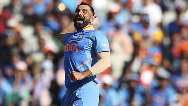 India's Mohammed Shami celebrates after taking the wicket of West Indies' Oshane Thomas.(AP)