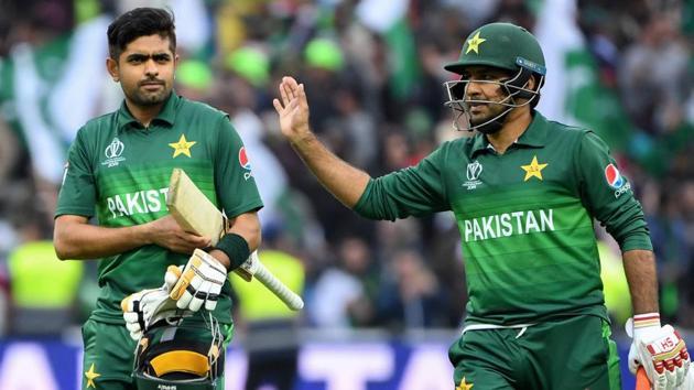 Pakistan's Babar Azam (L) and Pakistan's captain Sarfaraz Ahmed celebrate after victory.(AFP)