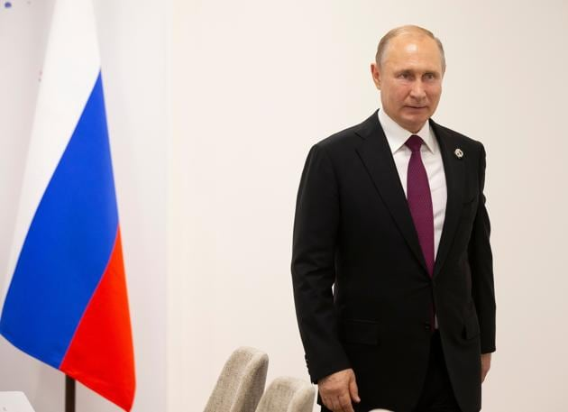 The Russian president, Vladimir Putin called German chancellor Angela Merkel's allowing large numbers of refugees to settle in Germany a 'cardinal mistake'.(AFP)