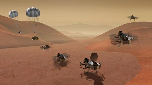 For its next mission in our solar system, NASA plans to fly a drone copter to Saturn's largest moon Titan in search of the building blocks of life(AP)