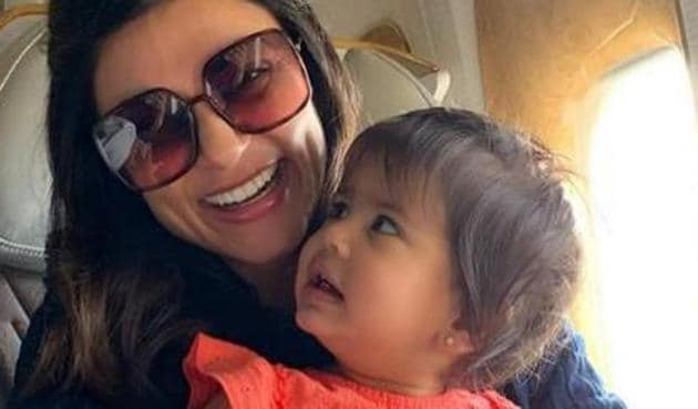 Sushmita Sen poses with a baby on an airplane.(Instagram)