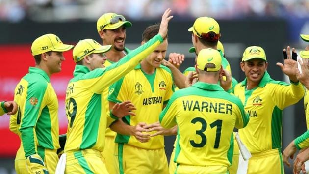 Australia's Jason Behrendorff and teammates celebrate taking the wicket of England's Chris Woakes(Action Images via Reuters)