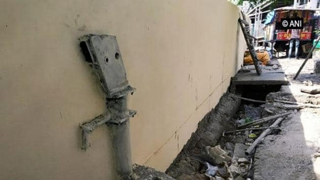 The handpump is said to have been situated where a boundary wall was planned.(Twitter/@ANI)