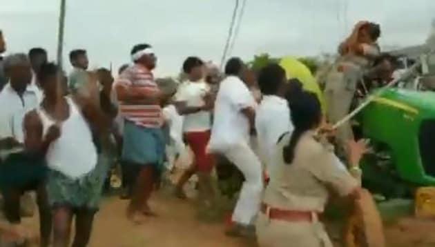 TRS MLA Koneru Konappa beat a woman forest officer with sticks on Sunday.(Screengrab/ANI)