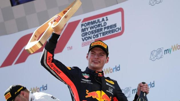 Red Bull's Max Verstappen celebrates after winning the race on the podium.(REUTERS)