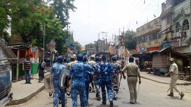 West Bengal, June 20 (ANI): Paramilitary personnel march as a clash broke out between two groups in Bhatpara on Thursday. (ANI Photo)
