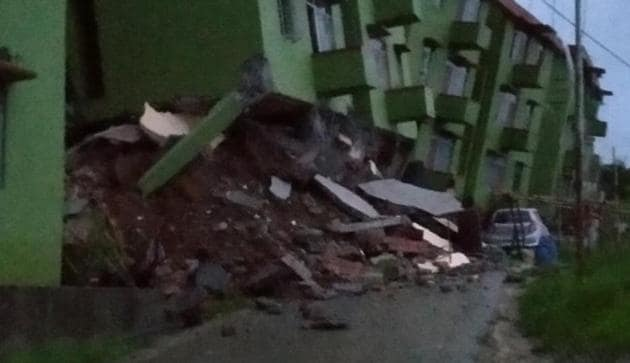Three blocks of a building complex on the outskirts of Aizawl collapsed due to landslide.(HT PHOTO)
