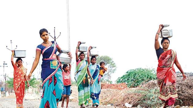 Women in Beed, some pregnant, have to walk at least 2km every day to fill a minimal amount of water.(Akshay Rade/ht photo)