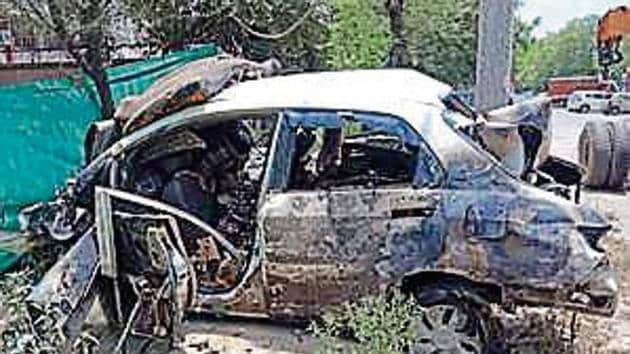 The car was charred in the incident.(HT PHoto)