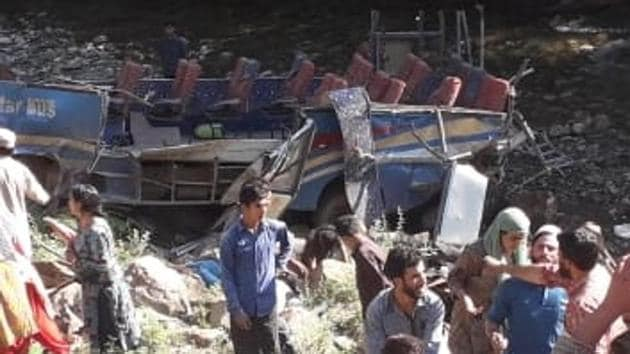 At least 35 people were killed and 17 others were injured when an overloaded mini bus veered off the road and fell into a deep gorge in Kishtwar district of Jammu and Kashmir on the morning of July 1, 2019.(HT Photo)