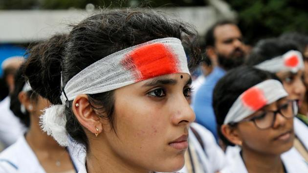 Medical students wearing mock bandages participate in a protest called by Indian Medical Association (IMA), during a nationwide doctors strike.(REUTERS)