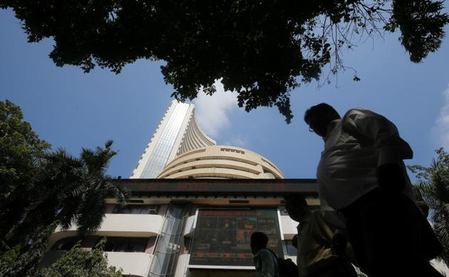 A man walks past the Bombay Stock Exchange (BSE) building in Mumbai.(Reuters)