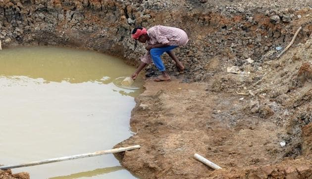 A worker collects the last bit of water from a small pond in the dried-out Puzhal reservoir on the outskirts of Chennai. Image for representation.(AFP file photo)