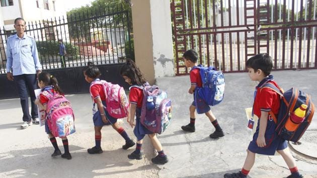 Children seen going school in Gurugram, India, on Monday. Parents of school-going children were unsure about the extension of summer holidays in the city till Monday morning.(Yogendra Kumar/HT PHOTO)