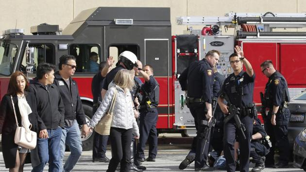 Police detain a man outside of the Tanforan Mall as shoppers are escorted out in San Bruno, Calif., Tuesday, July 2, 2019. Police are searching for suspects after at least two people were wounded in a mall shooting near San Francisco on Tuesday that led to region-wide transit delays at rush hour. (AP Photo/Stephanie Mullen)(AP)