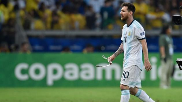 Argentina's Lionel Messi leaves the field during half-time of the Copa America football tournament semi-final match against Brazil at the Mineirao Stadium in Belo Horizonte, Brazil, on July 2, 2019(AFP)