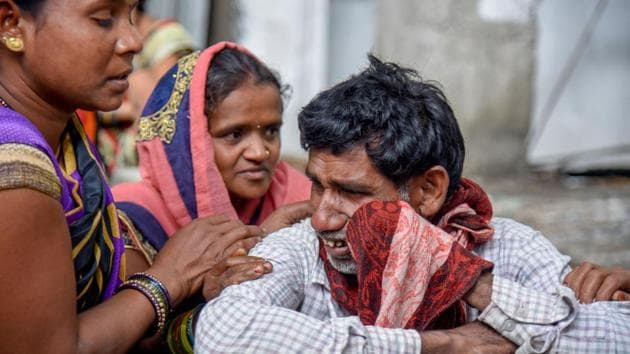 Relatives mourn the death of their deceased relatives at Sassoon hospital in Pune on Tuesday.(Sanket Wankhade/HT PHOTO)