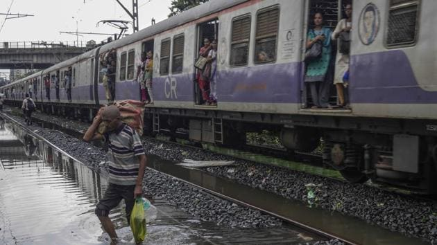 Central Railway resumed its local train services in Mumbai fully on Tuesday after more than 46 hours.(Bloomberg Photo)