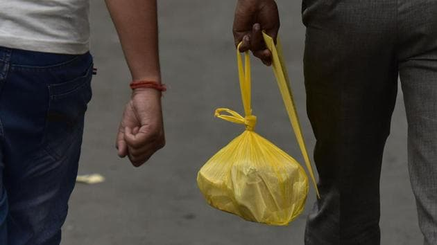A man carries a polythene bag in Noida, on Tuesday, July 2, 2019.(Virendra Singh Gosain/HT Photo)