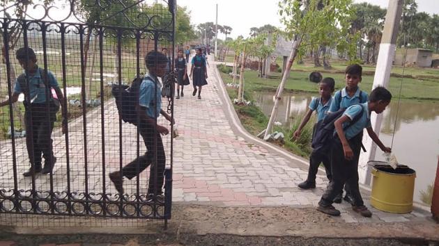 Students at the Padampani School in Bodh Gaya deposit waste in dustbins before entering the school(HT)