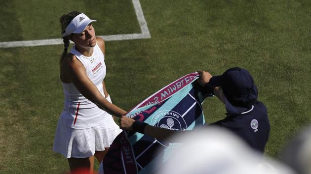Germany's Angelique Kerber reaches for her towel.(AP)