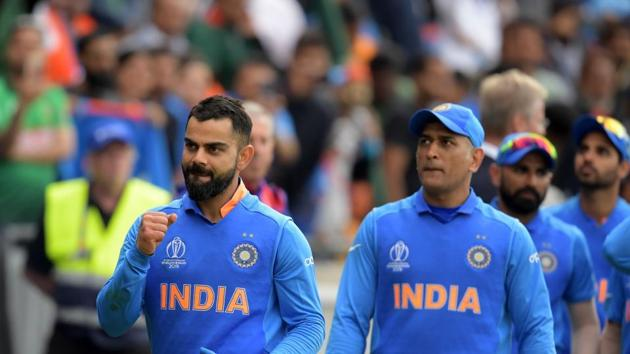 India's captain Virat Kohli (L) leads his team as they celebrate after victory in the 2019 Cricket World Cup group stage match between Bangladesh and India at Edgbaston in Birmingham.(AFP)