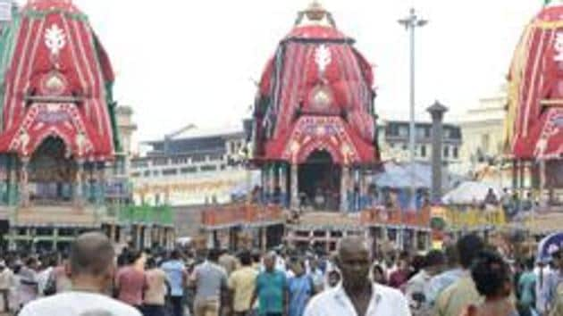 Devotees stand outside the Lord Jagannath temple ahead of the Rath Yatra in Puri on Wednesday.(ANI)