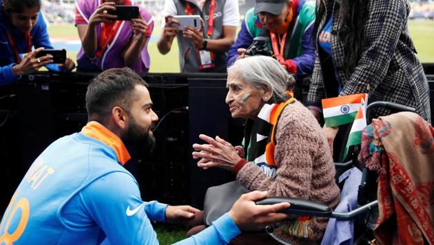 India's Virat Kohli meets India fan, Charu Latta Patel, at the end of the match(Action Images via Reuters)