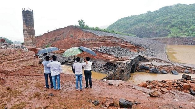 Officials of the irrigation department visit the breached Tiware dam near Chiplun in Ratnagiri, on Thursday. An SIT will now investigate if construction was faulty.(Pratham Gokhale/HT Photo)
