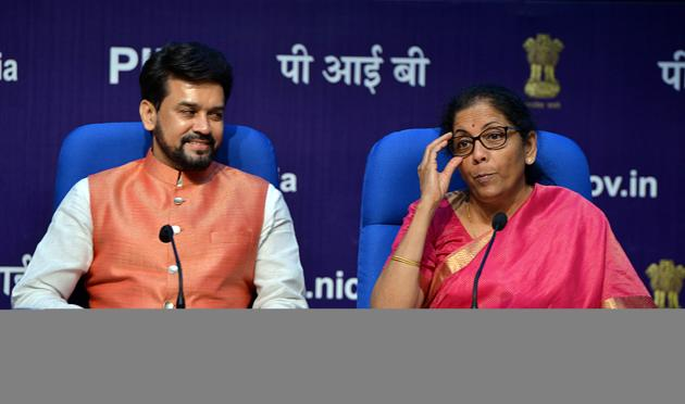 Union Finance Minister Nirmala Sitharaman addresses a press conference as Minister of State for Finance Anurag Thakur looks on after presenting the Union Budget in Parliament, in New Delhi on Friday.(ANI Photo)