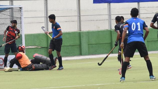 Krida Prabhodini striker Rahul Shinde (01) successfully strikes the ball goalward against Vikram Pillay Academy at the Major Dhyanchand Hockey Stadium in Pimpri-Chinchwad, on Thursday.(HT PHOTO)