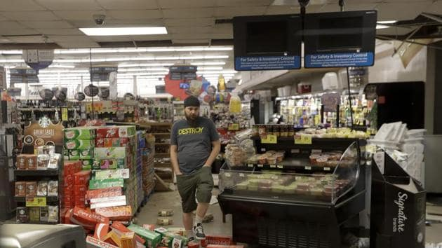 A worker steps over merchandise that is scattered on the floor of a Albertson's grocery store Saturday, July 6, 2019 following a earthquake in Ridgecrest, Calif.(AP)