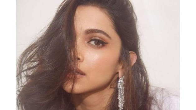 Actor Deepika Padukone teamed her white T-shirt with a pair of diamond ear pieces.