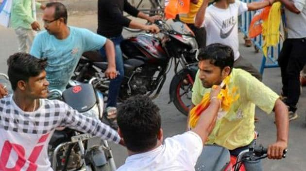 Police raided several places in Sadaipur, Mallarpur, Nanoor, and Rampurhat. At Mallarpur, a local club was destroyed by a blast in a densely populated area on 29 June. In this photo, BJP and TMC workers clash on counting day of LS elections 2019.(PTI File Photo)