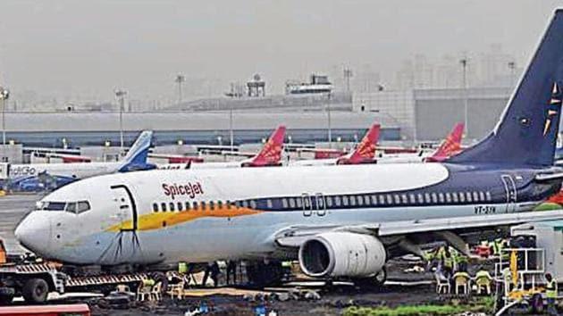 Airindia Authorities struggle to remove Spice jet aircraft,Which over short the main runway while landing at Mumbai Airport in Mumbai.(Satyabrata Tripathy/Hindustan Times)