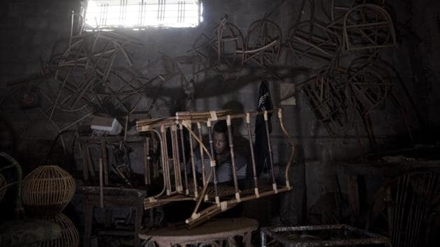 A Palestinian works at a bamboo workshop in Gaza City. Its living room sets, recliners, dining tables and chairs were once shipped to markets in the West Bank, Israel, Persian Gulf and America. The business flourished from 1975 until the outbreak of the second Palestinian uprising in 2000. (Khalil Hamra / AP)