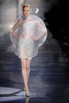 In 2010, Giorgio Armani's spring couture collection was luminescent and all about the moon. The models showcased shimmering gowns, orb-like outfits, and black jackets with crescent lapels, all in materials with a sheen as if moonbeams were reflecting off them.(Alamy Stock Photo)