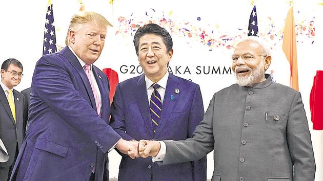 US President Donald Trump does a fist bump with Japan's Prime Minister Shinzo Abe and Prime Minister Narendra Modi during a trilateral meeting on the first day of the G20 summit on June 28, 2019, Osaka, Japan.(REUTERS)