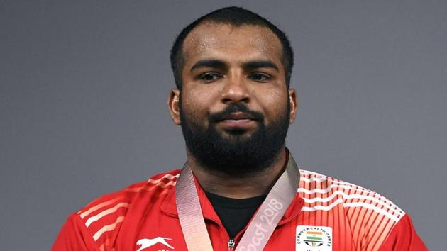 Pardeep Singh wins a gold medal in 109 Kg weightlifting.(AFP)