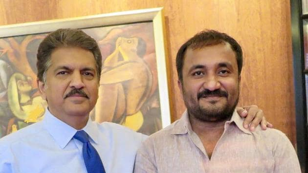 Anand Mahindra poses with Anand Kumar.